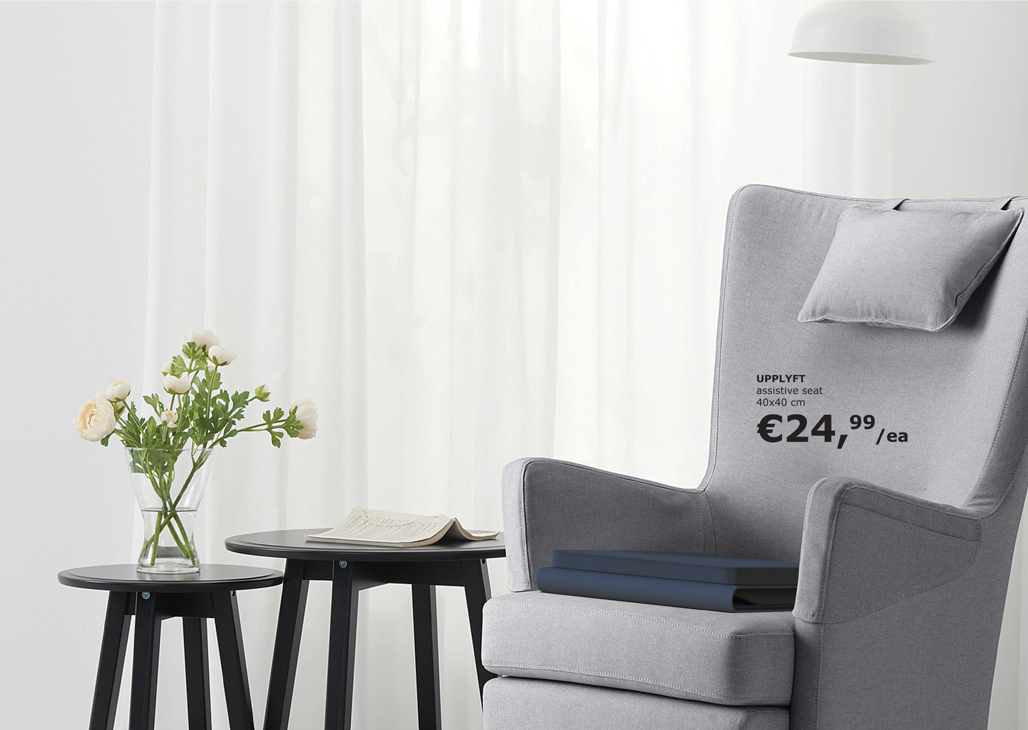 The  portable assistive seat placed on a grey armchair