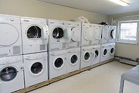 Laundry room with several laundry machines